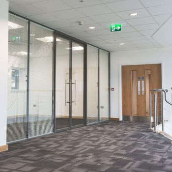 Floor to ceiling glass partition